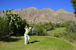 Skyline Country Club - Teeing off from a high tee box with a panoramic view of the mountains and golf homes in the Tucson community